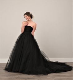 Twilight is a black wedding dress that is made to measure. Made of black matte polyester with an overskirt of black nylon tulle, the Twilight black wedding dress features a fully boned bodice and corset style grommet closure. Tulle Skirt Wedding Dress, Colored Wedding Dress, Tulle Wedding, Strapless Dress Formal, Black Tulle Dress, Prom Dress, Wedding Cake, Formal Dresses, Black Wedding Gowns