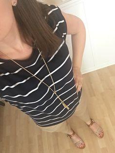 Navy striped shirt, skinny khakis, tassel necklace, gold sandals