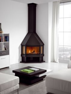 image result for lounges with corner round wood burners