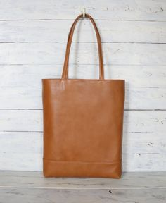Beautiful Italian Camel cow leather tote bag. Regular Price $198....... → $158 B-Grade Sale. There is a small scar and unevenness on the surface of a leather caused by the leather manufacturer. Please check the Photo no.4 & 2 but It will NOT effect the function of the item. Still very very beautiful leather . Details... Please visit our shop on Etsy!