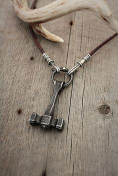 Blacksmith hammer necklace. Forged steel, fabricated sterling silver, with bronze on leather.