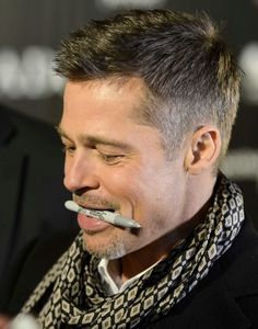 Brad Pitt -- I love how he holds the pen. Signing autographs for his fans at Allied premiere in Spain, wish I was there.