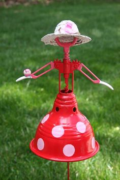 From Re-Scape.com: Sweet Southern Belle Garden Art from metal lampshade, corkscrew and a stake!