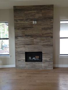 J Wood Tile makes an absolutely stunning fireplace.