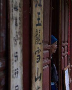 Chinese woman in doorway...Street photography...Gregoire Gardette (@gregoire.gardette) on Instagram