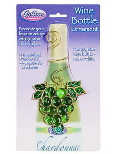 """Stained Glass Green Grapes Wine Bottle Ornament. Dress up your table with this festive, handcrafted stained glass wine bottle ornament. Perfect for gift-giving as well! Each is unique, hand washable, lead free, and will not fade. Fits any size bottle. 4"""" x 8"""". Designed in the USA. Web Exclusive! $17.99"""