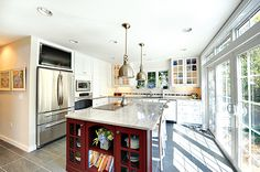 Two toned kitchen with painted white cabinets and painted red island. Cabinets And Countertops, Quartz Countertops, White Cabinets, Kitchen Cabinets, Two Tone Kitchen, Kitchen And Bath, Kitchen Cabinet Inspiration, Wellborn Cabinets, Island