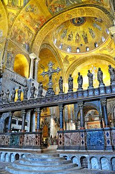 Venice, Italy - St. Mark's Cathedral - Under the Ascension Dome is the rood screen topped with 14 saints, it separates the congregation from the high altar.  The main altar has the remains of the evangelist Mark.  Above the altar is the masterpiece, the Golden Altar Screen.