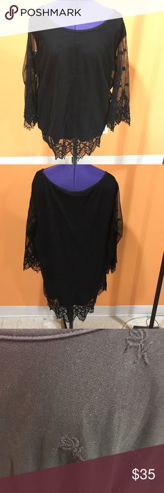 Black embroidered top Black top with small embroidered flowers all over shirt. Has lace at the bottom of shirt and sleeves. The sleeves are see through, but the body has a black lining underneath. Very cute to dress up or down! In great condition, no flaws. Torrid size 2. Feel free to make me a reasonable offer☺️ NO TRADES torrid Tops Blouses