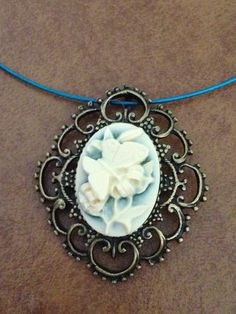 FREE US SHIPPING - Butterfly and flower cameo - cream on turquoise set in filigree brass on wire via Etsy