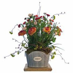 "Silk ranunculus and vine arrangement in a French garden bucket.  Product: Faux floral arrangementConstruction Material: Silk, plastic, and metalColor: Pink, red, yellow, and greenFeatures: Includes faux ranunculusDimensions: 21"" H x 16"" W x 15"" D"