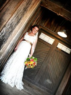 We love this brides feminine lace dress! See the rest of her country-chic wedding: http://www.bhg.com/wedding/real/real-weddings-a-modern-twist-on-country-chic/?socsrc=bhgpin062812#page=4