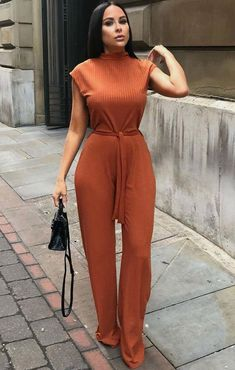 - Rust High Neck Ribbed Jumpsuit – Yasmine – 6 / Rust Rust High Neck Ribbed Jumpsuit – Yasmine Source by feijoaclub - Dope Outfits, Classy Outfits, Chic Outfits, Fashion Outfits, Jumpsuit Outfit, Fitted Jumpsuit, African Fashion Dresses, Overall, Mode Style