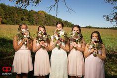 Elizabeth + Patrick's Wedding at Lenora's Legacy. Photo credit: Cureton Photography Bridesmaids with bouquets.