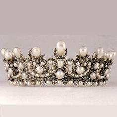 Empress Eugenie Tiara, executed by Lemonnier mid-19th century, is based on neo-classical design belonging of Louis XVI style, in which the filigree silver-gilt mount is over crusted with small brilliant-cut diamonds, totaling 1998 diamonds in all, total weight of 63.30 carats. The origin of the pearls used is believed to be originally part of a magnifient pearl parure that was presented to Empress Marie Louise, Napoleon Bonaparte's second wife