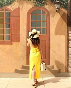 Yellow maxi Dress with tie back bow, floppy hat, and Pom Pom tote!   Yellow outfit ideas Summer dresses Spring dresses Maxi dresses