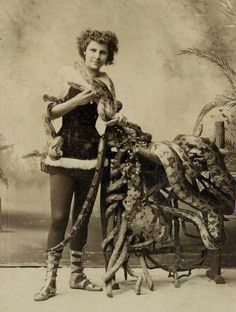 Vintage circus photo sideshow of snakes. FATA MORGANA