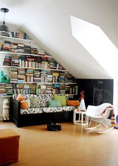 I like the idea of using the slanted walls for bookshelves...looking for something to do with ours! I don't know whether the bed would fit in the middle of the room, though.