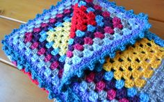 Cheerful Granny Square Baby Blanket | If you're looking for a crochet baby blanket pattern that's not limited to pink or blue yarn, then this pattern is for you. You might even be able to reach into your yarn stash to make this project!