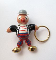 Clown with Hoop Puffed Figural Pin    In excellent condition, near mint. Unsigned. Circa 1940.