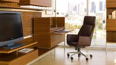 Conference Chair: Bindu executive chair by Coalesse; shown with the Denizen collection of casegoods.