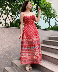 ANITA DONGRE Featuring a red strappy dress in lyocell, linen, metallised fiber and polyester base. It has floral and elephant motifs, sweetheart neckline and print. Kurta Designs, Kurti Designs Party Wear, Frock Fashion, Fashion Dresses, Dress Outfits, Dress Up, Fashion Top, Fashion Edgy, Dress Lace