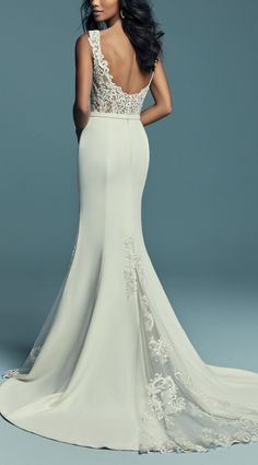 Maggie Sottero - JAYLEEN, This unique wedding dress features a bodice accented in beaded lace motifs, completing the illusion bateau neckline and straps, a sheer scoop back with crosshatch detail. Aldora Crepe fit-and-flare skirt features tulle and lace godets at the sides and back, all accented in lace motifs. #MaggieSottero #Maggiebride #mylovestory