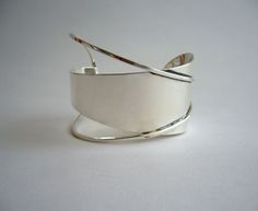 """A large sterling silver bracelet designed by Paul Lobel of New York. Lobel had a studio and retail shop in New York's Greenwich Village in the 1940's and 1950's. His work has been included in museum exhibitions worldwide. Bracelet measures 2"""" at its widest dimension. Signed Lobel, Sterling and in excellent condition."""