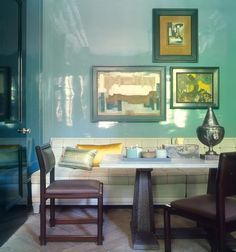 High gloss lacquer wall in light blue dining room. http://cococozy.com
