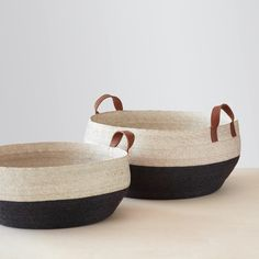 The Citizenry Mercado Floor Baskets - Black. Browse inspirational photos of modern homes. From midcentury modern to prefab housing and renovations, these stylish spaces suit every taste. Southwestern Decorating, Global Design, Basket Decoration, Black Media, Storage Baskets, Leather Handle, Straw Bag, Wicker, Flooring