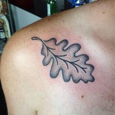 Hand poked oak leaf tattoo on the shoulder.