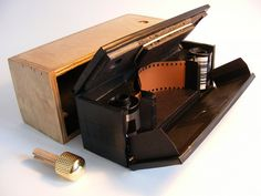 Gonzorama Deluxe Mk4 exploded view  35mm curved plane panoramic pinhole camera. The loaded foamcore box closes up and slides into the wood outer skin with the winding peg holding it in.