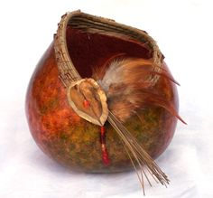 Recent Works   Gloria's Gourd Art-Colored with alcohol inks with a pine needle rim. Feathers, beads and pod was added.