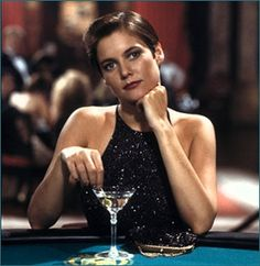 50 Years of Bond Girl Fashion: Carey Lowell as Pam Bouvier in Licence to Kill, 1989: It's rare to see a short-haired bond girl (well, except for Grace Jones, but she's in her own category). Her gamine looks and not-sleazy gown are very classy.