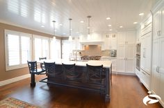 Stunning kitchen! #hangingchairs #swingoutseats #barstools #kitchendesign   Find us @ www.seatinginnovations.com