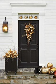 Love this gilded gold pumpkin door decoration idea for Halloween.