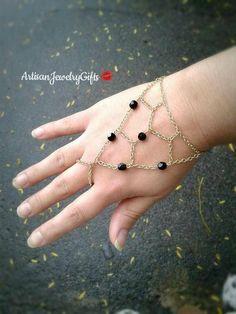Boho slave bracelet black Czech glass beaded gold net hand chain.