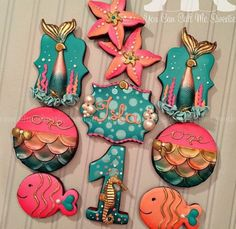 Under the Sea Glam cookies for Isla's birthday! I got inspiration of the mermaid cookie from an Oreo my friend had done a while back using my tutu ruffle technique :) Thanks Jess! Summer Cookies, Fancy Cookies, Iced Cookies, Cute Cookies, Royal Icing Cookies, Cupcake Cookies, Baby Cupcake, Mermaid Cookies, Galletas Cookies