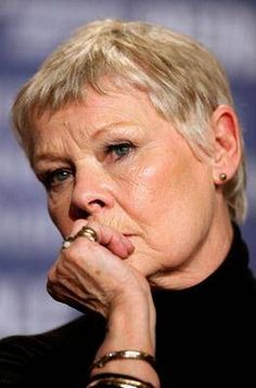 Beautiful look and use of her hair's textures. Ms Dench looks great in these short pixie style layers.