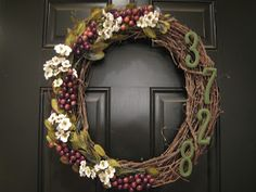 teach. craft. love.: Winter Wreath I would probably make this a little less floral-y for my taste, but I love the idea of putting the house number on the wreath.