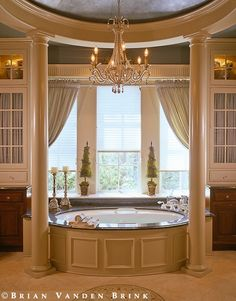 fancy but simple? might be a little over-the-top, but it's pretty and i'm a sucker for a bathroom that has a chandelier.