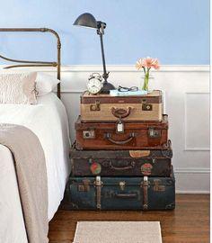 Sunroom idea with suitcases, thrift store lamp, vase, clock, etc.