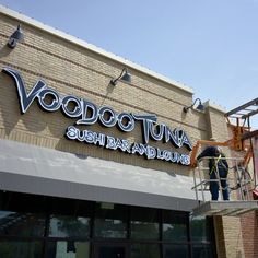 Sign points to VooDoo. @VoodooTunaCLE Sushi Bar and Lounge opening soon in Lakewood. http://t.co/QENbBv3Qlo