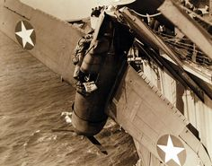 Crash of onboard USS Charger (ACV Shown is the position of the plane and damage and rescue of pilot. Photographed March U. Navy photograph, now in the collections of the National Archives. Navy Aircraft, Military Aircraft, Ww2 Fighter Planes, Aviation Accidents, National Archives, Time Photo, Aircraft Carrier, War Machine, Wwii