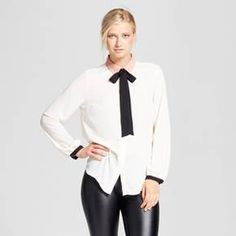The simple addition that elevates an entire outfit: the Femme Bow Blouse - Who What Wear™. A feminine bow adds bold contrast on a sophisticated blouse; the black cuffs and taupe collar add more neutral-but-noticeable touches. Youthful and fun with wide-leg trousers, or try it as a trendy take over a midi skirt or your latest denim obsession.