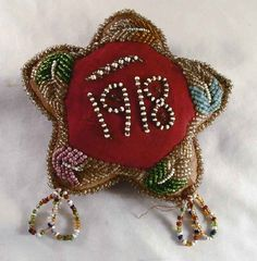 Description: This is a beautiful, most likely handmade, antique star shaped stuffed cloth pincushion. These pincushions and other similar items were made by native American Tribes (Iroquois?) in Upsta
