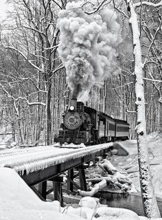Winter....steam locomotive on the bridge enters