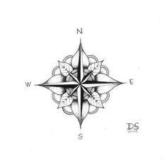 blumen, weiße blätter und ein kleiner schwarzer kompass  idee für einen kleinen eleganten compass tattoo