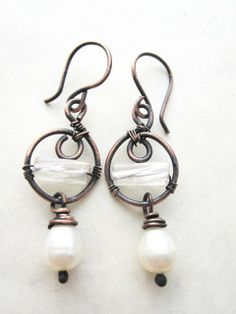 Маша. Copper pearl earrings by Mary Bulanova.