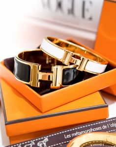 Beautiful Hermes bracelets in the iconic orange box. Hermes Armband, Hermes H Bracelet, Hermes Jewelry, Enamel Jewelry, Bracelets, Hermes Bangle, Jewlery, Jewelry Accessories, Fashion Accessories
